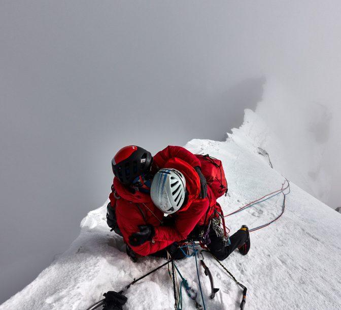 Malcolm (black helmet) and Paul Figg celebrate reaching the summit of Janhukot. Photo:Guy Buckingham