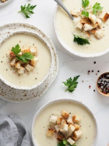cauliflower artichoke soup in bowls