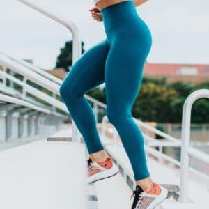 woman on steps, best beachbody workout