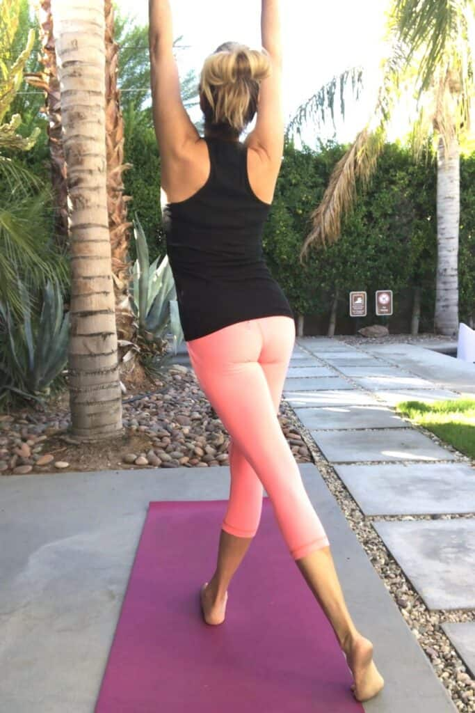 woman doing yoga and getting fit after 50