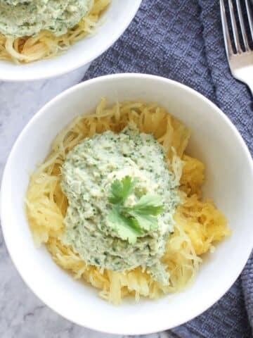 spaghetti squash with pesto in a bowl