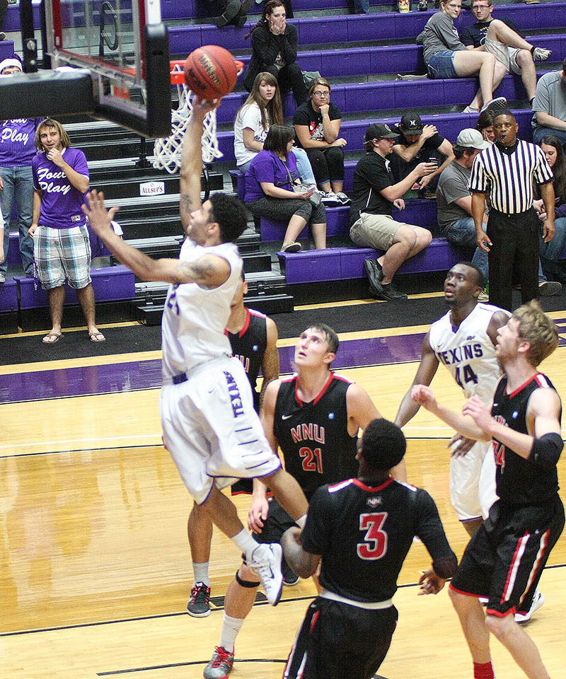Michael Hardge finishes at the rim for two of his eight points in Tarleton State's victory over Northwest Nazarene Saturday. || Photo by BRAD KEITH