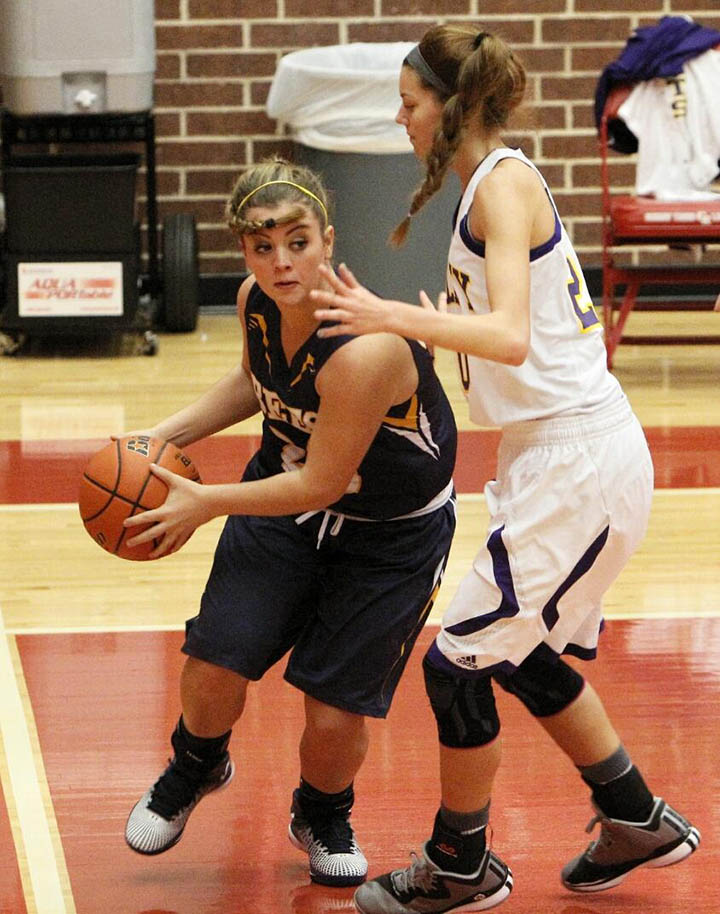 Lyndi Graham leans around a Godley defender in the championship of tournament play in Glen Rose Saturday. || Photo by RUSSELL HUFFMAN