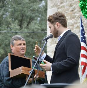 Dublin Mayor David Leatherwood presents Luke Wade with a key to the city and a soda from Dublin Bottling Works. || Photo by BROOKE MENDENHALL