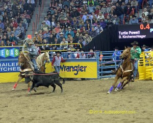 Turtle Powell of Stephenville and Dakota Kirchenschlager of Morgan Mill dominated the team roping in 4.0 seconds Thursday night, winning the first go-round of the 2014 Wrangler National Finals Rodeo by half a second. || Photo by DUDLEY BARKER, dudleydoright.com
