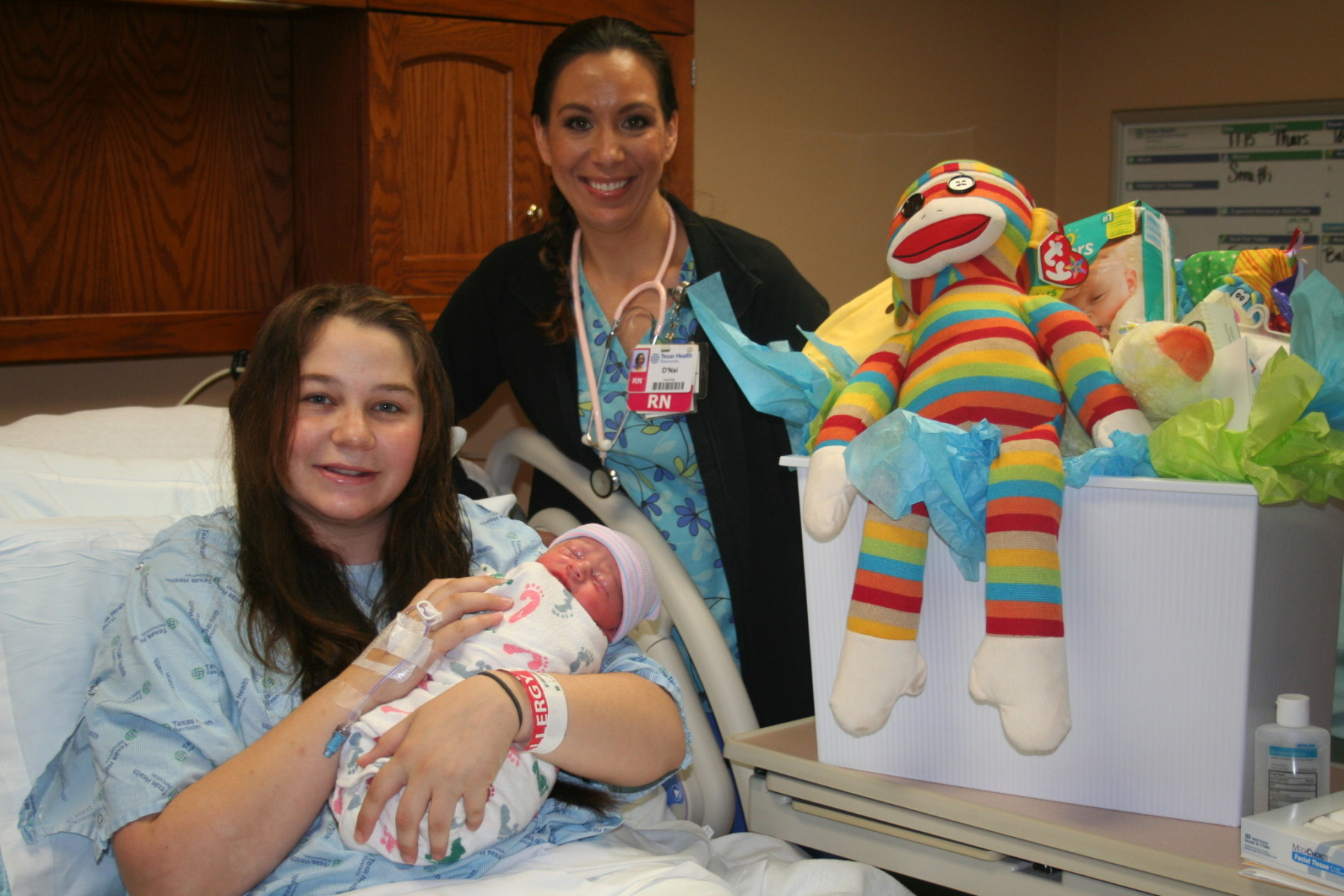 Aiden Allan, born January 2 and weighing 8lbs.1oz., was the first baby born at the hospital in 2015 at Texas Health Harris Methodist Hospital Stephenville. He is pictured here with mother Emily Varney and D'Nai Johnson, RN.