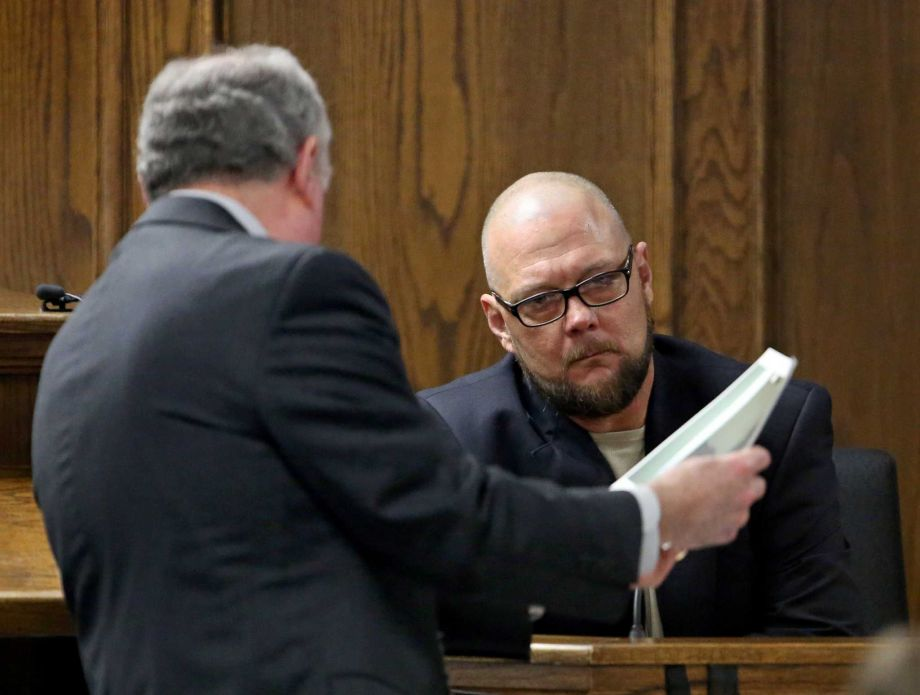 Court appointed defense attorney Tim Moore, left, shows James Watson, uncle to ex-Marine Eddie Ray Routh, photographs that are evidence from Routh's house during testimony in Routh's capital murder trial at the Erath County, Donald R. Jones Justice Center in Stephenville, Texas, Friday, Feb. 13, 2015. Routh, 27, of Lancaster, is charged with the 2013 deaths of former Navy SEAL Chris Kyle and his friend Chad Littlefield at a shooting range near Glen Rose, Texas. Watson testified that he smoked marijuana with Routh on the day of the killings. (AP Photo/The Fort Worth Star-Telegram, Paul Moseley, Pool)