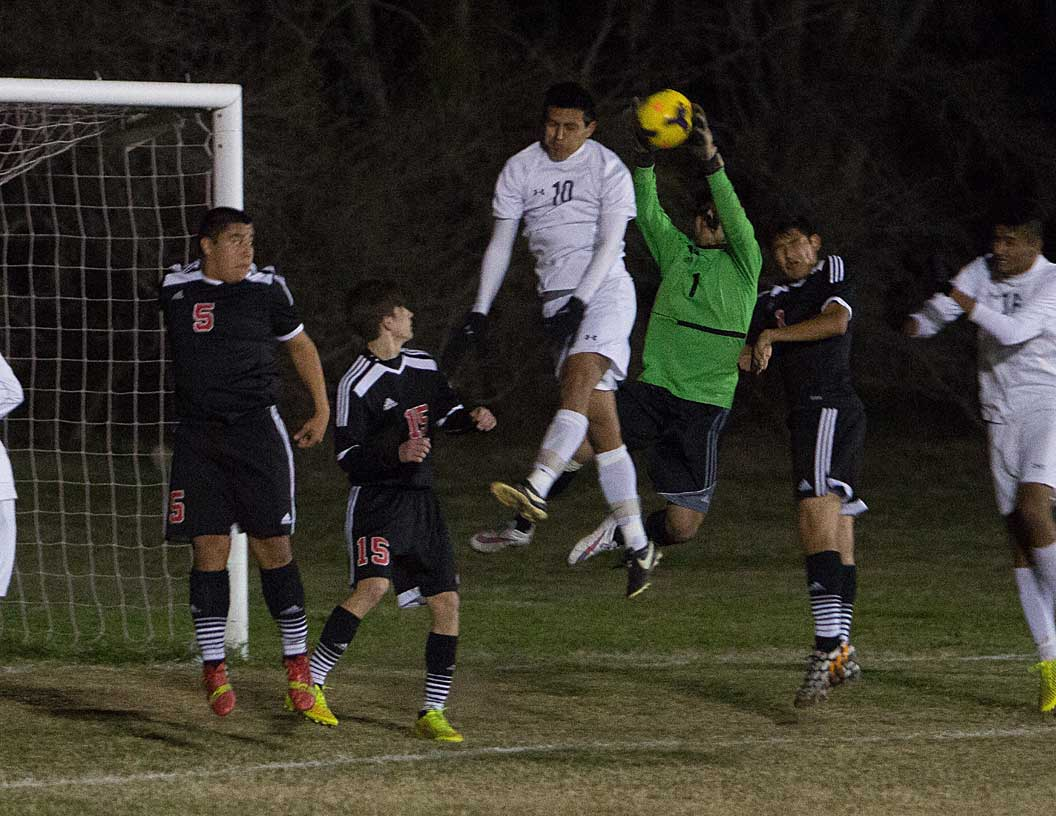 Felipe Espinoza tries to head one against the Mineral Wells keeper Friday night. || Photo by RUSSELL HUFFMAN