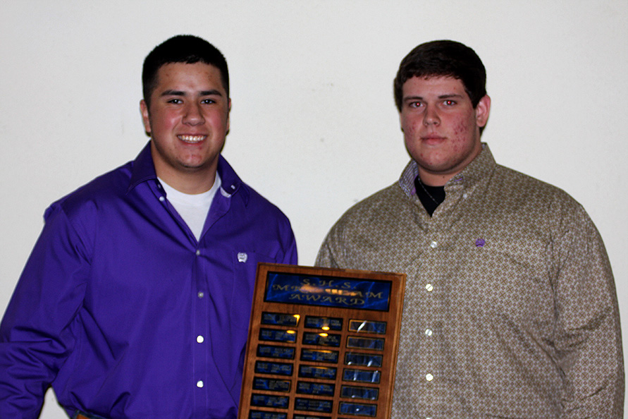 Football players voted for teammates Noah Perez, left, and Cameron Reynolds to be honored at Monday's banquet at City Hall on the grounds of City Limits. || Photo by BRAD KEITH