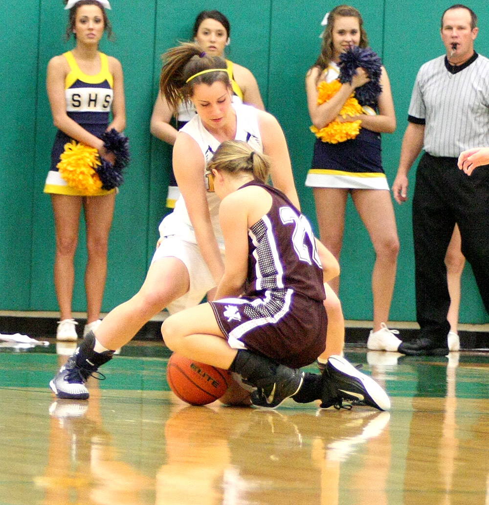 Junior Mikayla Hobbs of Stephenville fights for Jaci Daniels of Vernon for a loose ball during Tuesday's bi-district playoff in Breckenridge. || Photo by BRAD KEITH