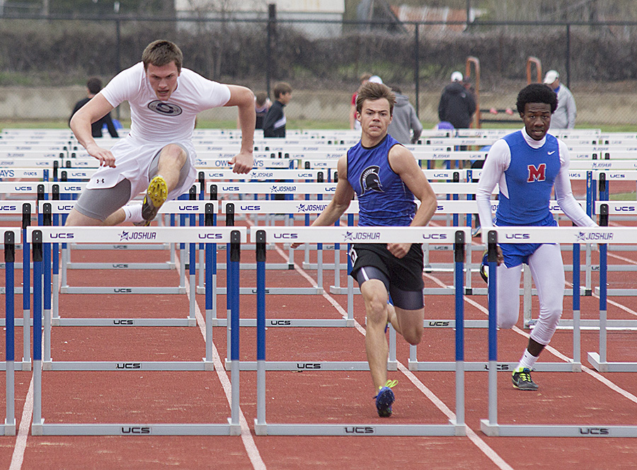 Austin Stufflebean clears the last hurdle on his way to a sixth-place finish. || Photo courtesy Dr. CHET MARTIN