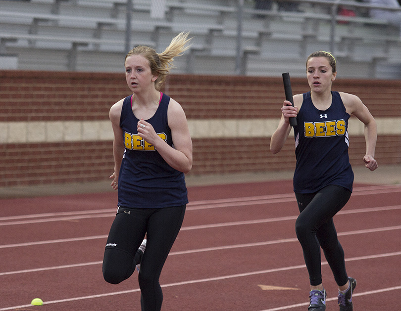 Maddi Cashell prepares to take a handoff from Hailey Martin during a relay event. || Photo courtesy Dr. CHET MARTIN