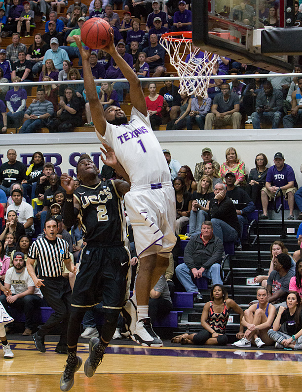 Tarleton junior guard Malcolm Hamilton skies for a dunk against UC-Colorado Springs Sunday. || Photo by RUSSELL HUFFMAN