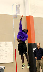 NFL hopeful Clifton Rhodes III is measured in the vertical leap Wednesday. || BRAD KEITH/TheFlashToday.com