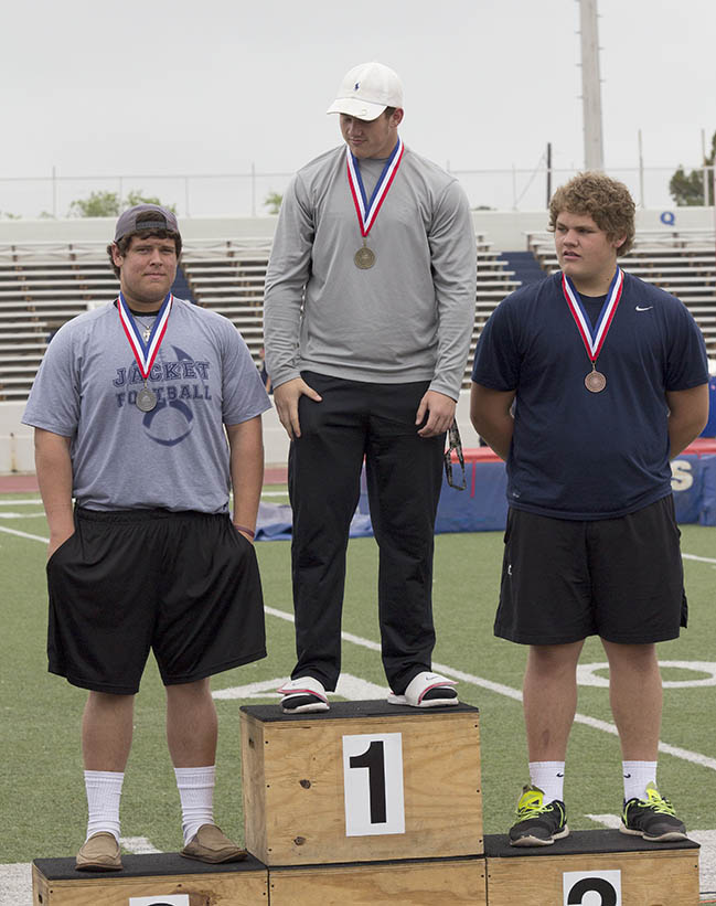 Senior thrower Cameron Reynolds dons his silver medal for placing second in the shot put at the area track and field meet in Graham Thursday. || Dr. CHET MARTIN