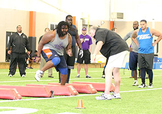 Tarleton defensive lineman Chris Brown goes through a drill under the instruction of a Carolina Panthers scout Wednesday. || BRAD KEITH/TheFlashToday.com