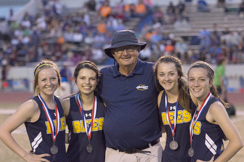 Coach Mike Copeland with one of his region-bound relay clubs. || Courtesy Dr. CHET MARTIN