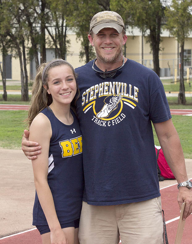 Versatile freshman Hailey Martin and coach Jeremiah Boutchey were all smiles after she placed second in the triple jump. || Dr. CHET MARTIN