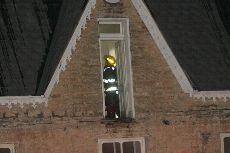 A firefighter works upstairs in a two-story building at the Stephenville Historical Museum just before 1 a.m. Wednesday. || BRAD KEITH/TheFlashToday.com