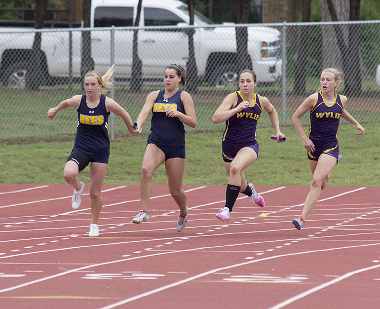 Mikayla Hobbs hands off to Maddi Cashell during a girls relay event. || Courtesy Dr. CHET MARTIN