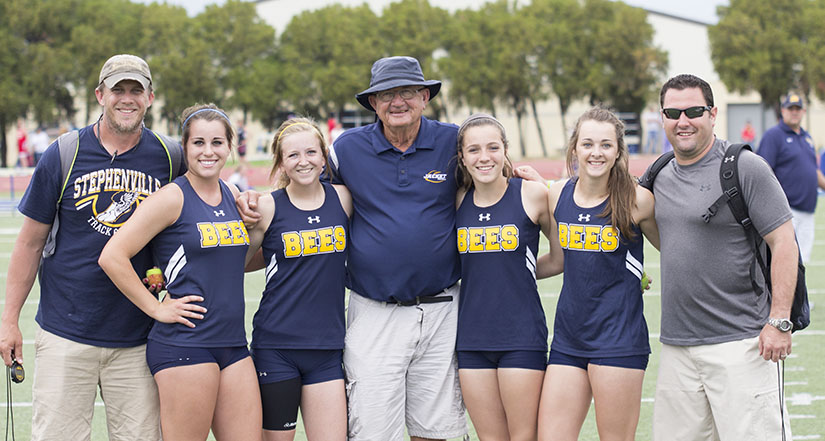 Coach Mike Copeland celebrates with one of his relay clubs. || Courtesy Dr. CHET MARTIN