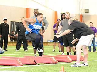 Tarleton defensive lineman Juan Gonzalez is drilled by a scout with the Carolina Panthers. || BRAD KEITH/TheFlashToday.com