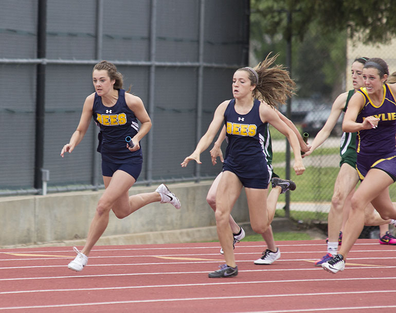 Cassidy Cline takes a handoff from Hailey Martin in the girls 4x100-meter dash. || Courtesy Dr. CHET MARTIN