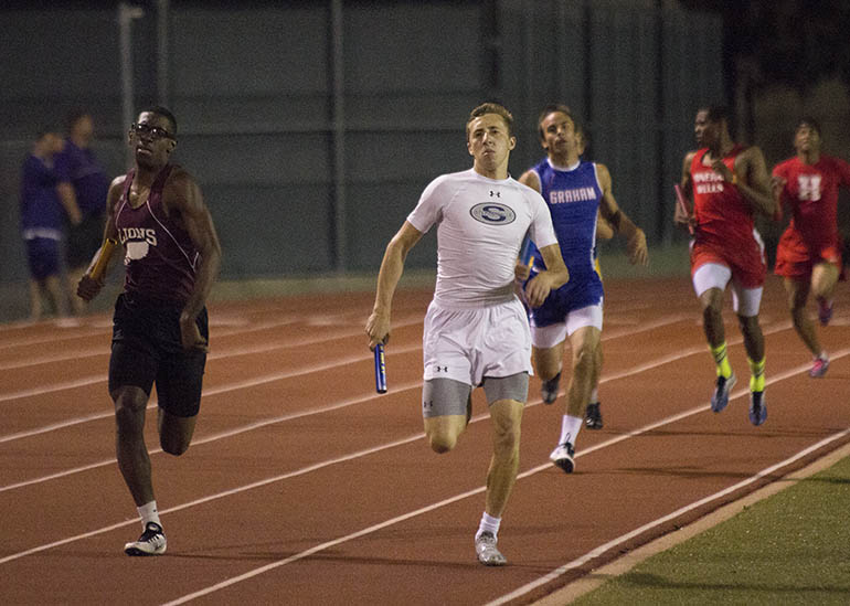 Tyler Griffin runs the second leg of the boys 4x400-meter relay. || Courtesy Dr. CHET MARTIN