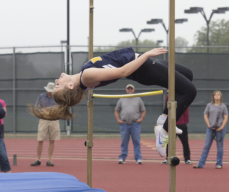 Kaleigh Conger clears the bar in the girls high jump. She finished fifth but will replace teammate Jordan Carter at next week's regional competition. || Dr. CHET MARTIN