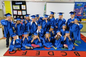 Kasha Lewis' Kindergarden grads clowning after a serious group shot. Caden, in the center, is Kasha's son, and according to Cindy Shipman, who took this photo, he instigated the silly monster faces.