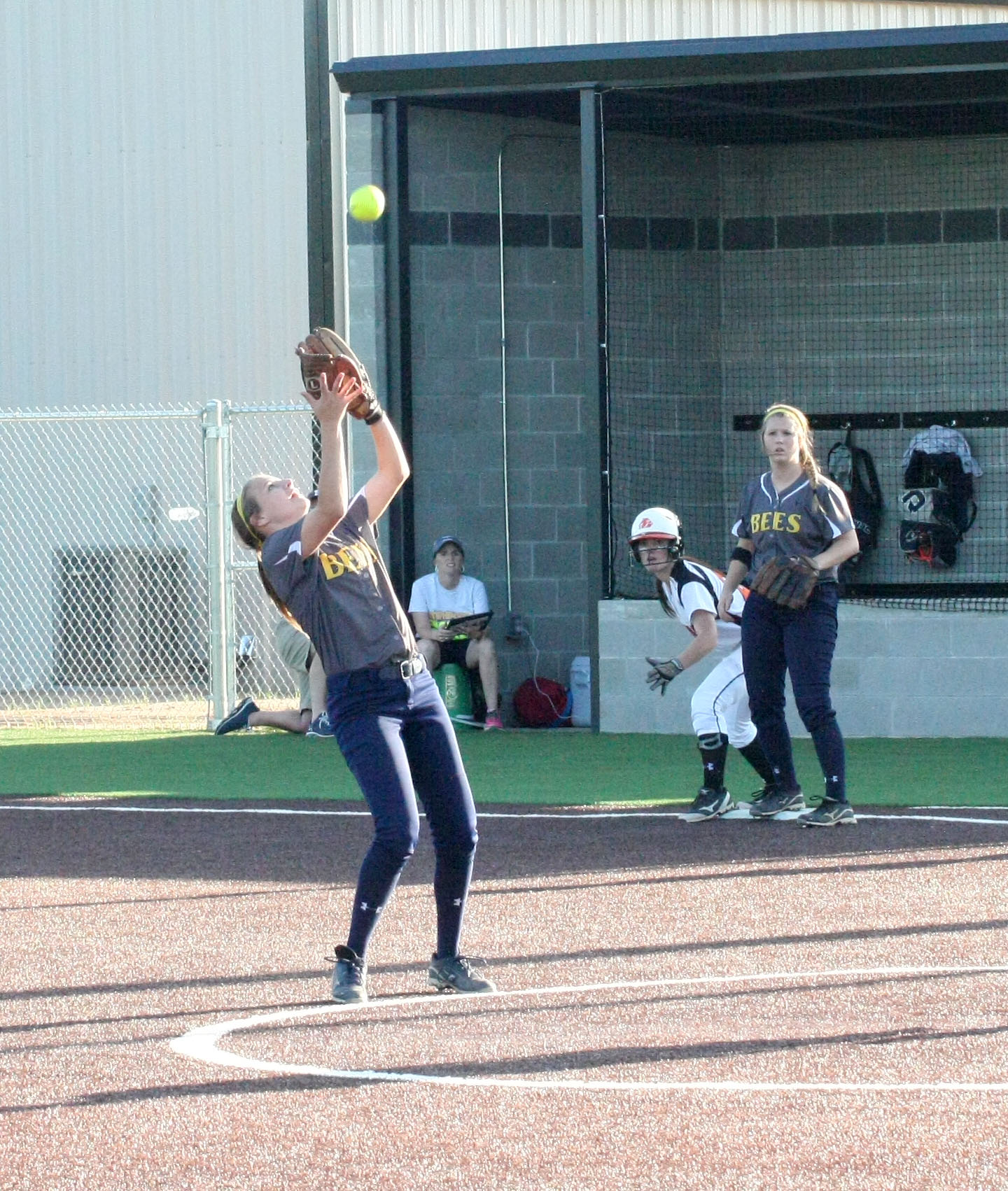 Stephenville junior second baseman Kali Smith puts away a pop up during game one of a best-of-three bi-district softball series Friday. || BRAD KEITH/TheFlashToday.com