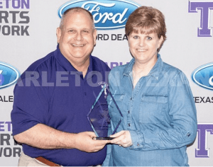 Mike and Jill Scott are shown receiving the All-Purple award for continued service to the Tarleton Athletics Department. Mike has been named the new superintendent of Erath Excels ISD, which includes Huston Academy in Stephenville. || Courtesy TARLETON ATHLETIC MEDIA RELATIONS