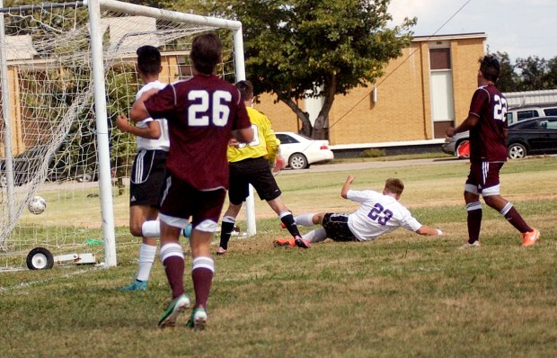 Ranger College's Callum Wagstaff boots a kick past Schreiner University's goalie while sliding in front of the net. Wagstaff's goal was one of three by the Rangers in the first half of Monday's 9-0 non-conference win. Ranger College's next home game will be at 4 p.m. on Oct. 9 against SW Adventist University.