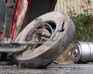 This tire shows significant damage and was off the rim following the accident.