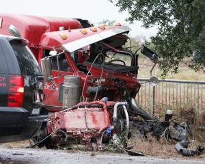 The collision was so violent the truck's front axle, engine, and transmission all separated in pieces. The driver was ejected from the cab of the truck and pronounced dead at the scene.