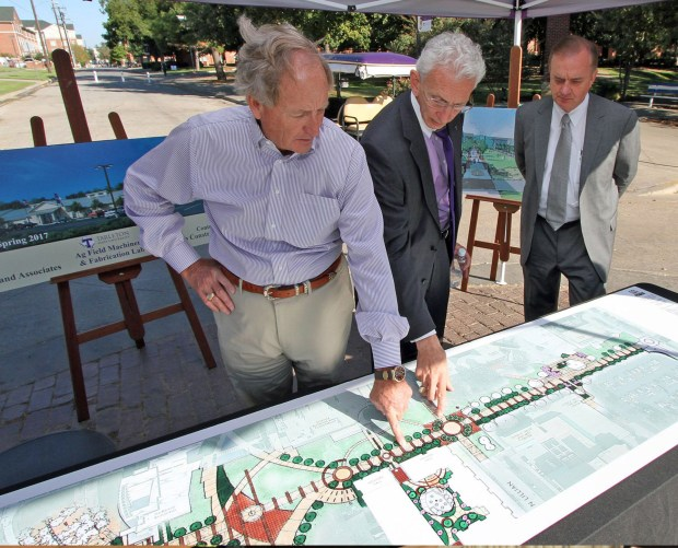 Texas A&M University System Regent Robert L. Albritton, Tarleton President F. Dominic Dottavio and A&M System Chancellor John Sharp review architectural renderings of the Centennial Mall Project.