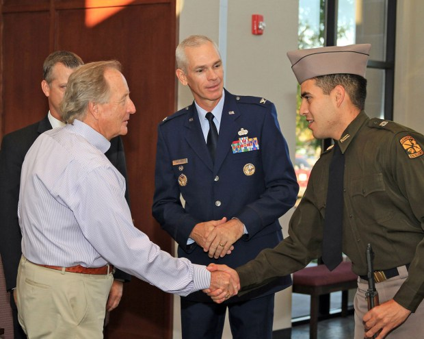 Tarleton ROTC Cadet Jonathan Torres greets Chancellor Sharp during an overview of Tarleton's revived Corps of Cadets leadership program as Corps Commandant Kenny Weldon looks on.