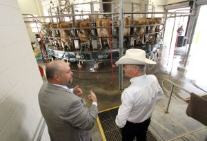 """Dr. Barry Lambert, Tarleton's Associate Vice President for Research and Dean of the College of Graduate Studies (left), explains research and outreach efforts to state Rep. Charles """"Doc"""" Anderson during a tour of the university's Southwest Regional Dairy Center."""