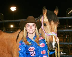 Ranger College freshman Jackie Ganter stands with her horse, French Jet, after making 10 perfect runs at the National Finals Rodeo in Las Vegas. With her effort, the Abilene, Texas, native earned the 2015 Professional Rodeo Cowgirls Association's Rookie of the Year honors. (Photo courtesy Jackie Ganter)