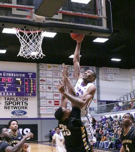 Senior power forward EJ Reed, showing trying to dunk over a Cameron defender, scored 19 points and collected 12 rebounds for his seventh double-double of the season. || TheFlashToday.com photo by RUSSELL HUFFMAN