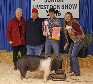 Sidney Love won reserve champion in the market swine division with this light medium weight cross. It was purchased by Kwik Car Oil & Lube for $2,500.