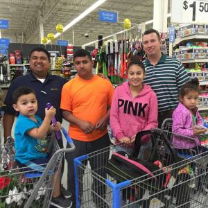 Julian, Felicia, and their beautiful family #DayItForward in Walmart with Audiel Solis (L) and Kyle Masters (R). || Bruner photo