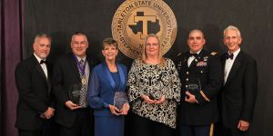 The Tarleton Alumni Association presented several awards Saturday evening during the university's annual Gala. Pictured (l-r) are TAA Board of Directors' President Dr. Luke Lawson, 2016 Distinguished Alumnus Chuck Gilliland, 2016 Distinguished Faculty Dr. Jill Burk, 2016 Distinguished Staff Vickie Swam, Outstanding Young Alumnus Maj. John Considine, and Tarleton President F. Dominic Dottavio.
