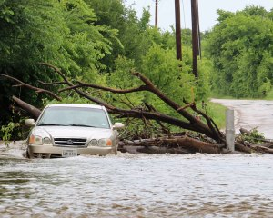 The low-water crossing on County Road 185 was a dangerous situation as one poor driver found out Tuesday.