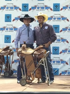 Sy Felton with the mayor of Gallup, NM and the saddle for winning the calf roping championship at the Best of the Best Timed Event Rodeo. || Courtesy MISSY FELTON