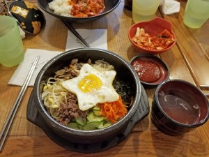 Bimbab is a very popular dish in Korea with rice underneath served with miso soup, kimchi, and pickled radish.