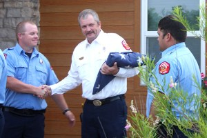 """Jerry Powers shakes hands with his """"brothers"""" after they honored him Friday morning for his 31 years of service to Stephenville Fire Department. 