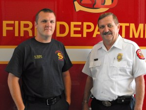 Stephenville's newest firefighter/paramedic, Robert Maiden, with Chief Chew.  Monday was Maiden's first day on the job in Stephenville. || DAVID SWEARINGEN photo