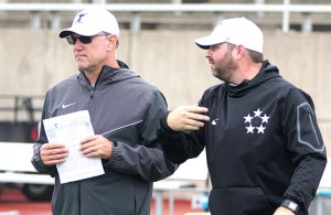 Head coach Todd Whitten, left, and offensive coordinator Mason Miller discuss offense during a preseason practice at Tarleton. || TheFlashToday.com photo by BRAD KEITH