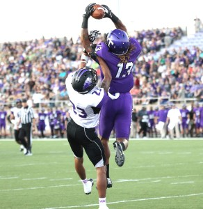 Junior wideout Del'Michael High goes upstairs for a touchdown reception against Southwest Baptist University earlier this season. || TheFlashToday.com photo by RUSSELL HUFFMAN